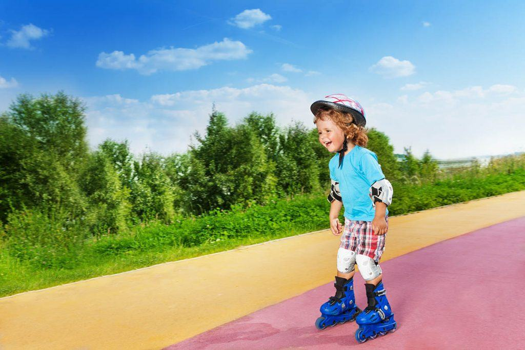 toddler roller skating downhill